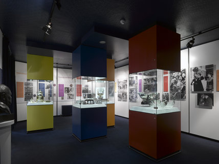 the museum room with display cabinets containing gifts and With kitchen cabinets lowes with winston churchill wall art