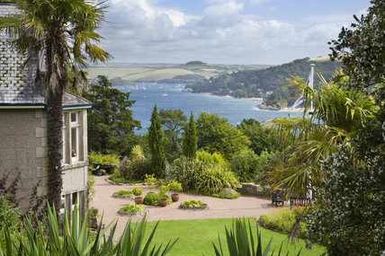 The view over the Salcombe estuary with the house and garden at Overbeck's, Devon