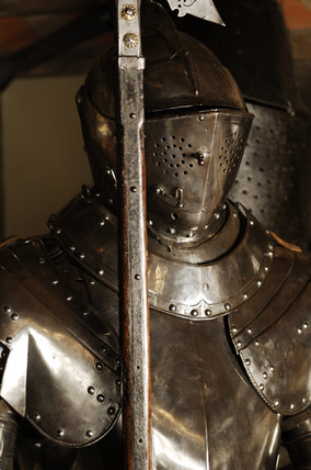 Close view of parts of a three-quarter suit of German armour at Snowshill Manor, in the room known as Dragon