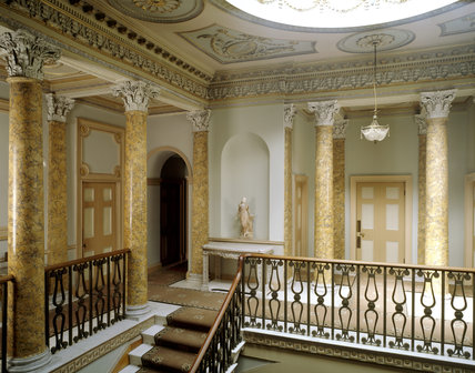 A view of the Staircase Hall, which fills the middle of the house and the picturesque effect owing much to the fantasy views Italian designer Piranesi, the present colours are from 1908