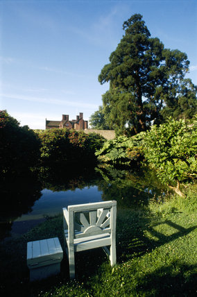 Chartwell, view of the garden with a chair in the foreground
