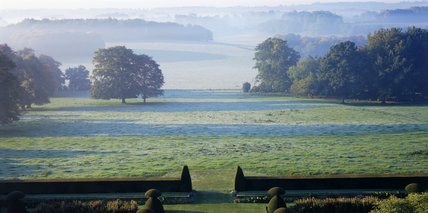 Misty view across the park at Hinton Ampner in October showing the bastion