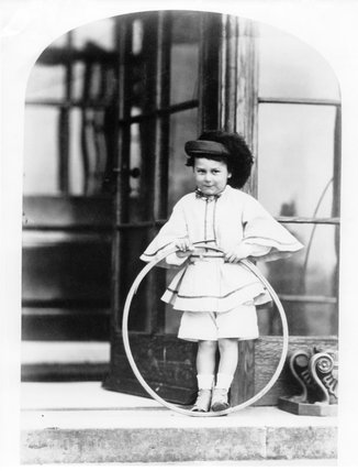 George William henry Vernon, 7th Baron, aged 4 in 1858 holding a hola hoop at Sudbury Hall