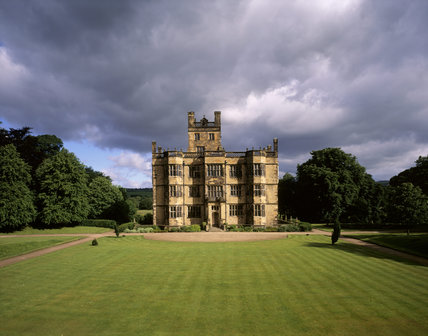 A view of the South Front of Gawthorpe Hall set in it's grounds on a stormy day
