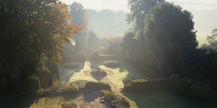 Misty view across the yew garden at Hinton Ampner in October