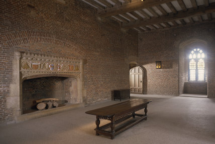 The main hall on the 1rst floor with the chimneypiece which is crenellated on supporting, columns, bearing roundels carved with Cromwell's Treasurer's purse & coat of arms & those of his ancestors