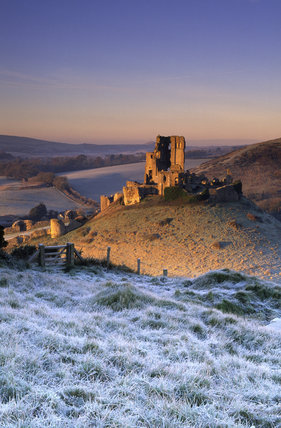 Sunrise at Corfe Castle from East Hill (grid reference SY961823) Wareham, Dorset, UK, on a frosty winters morning