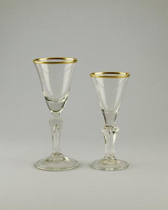 Shugborough Hall, two english funnel shaped glasses with gilt rims c.1740