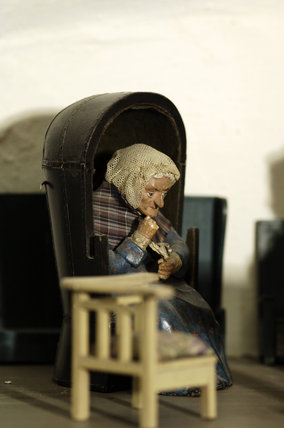 Close view of one of the figures of an old lady, one of a pair, which were popular golden wedding gifts