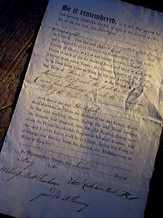 A close up of a contract between Samuel Greg, owner of Quarry Bank Mill, Styal, and a worker named Cook, dated May 1796