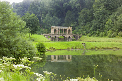 A long view of the Palladian Bridge at Prior Park, Bath, UK - a landscape garden designed for Ralph Allen in the eighteenth century with the advice of both Capability Brown and Alexander Pope