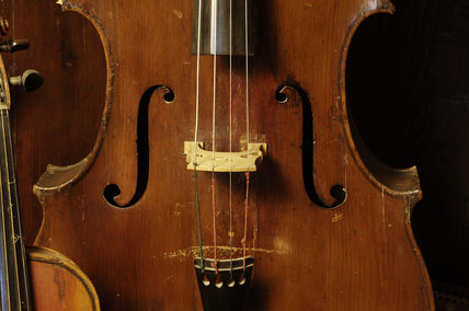 A double bass, part of the musical instrument collection of Charles Paget Wade in the Music Room at Snowshill Manor, Gloucestershire