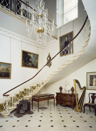 Room view of the Staircase Hall showing chandelier, bell and harp
