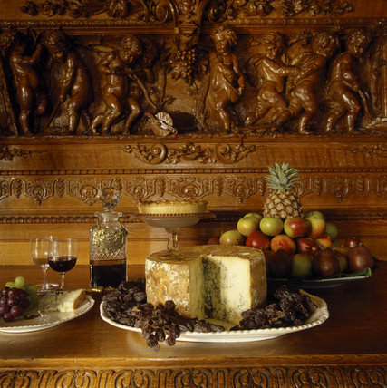 Detail of food laid out on a wooden table in The Dining Room at Charlecote Park