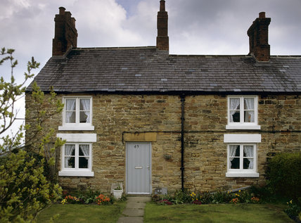 The terraced cottage built of the local sandstone, lies in the village of Hardstoft, a former mining community in the Hardwick Hall estate