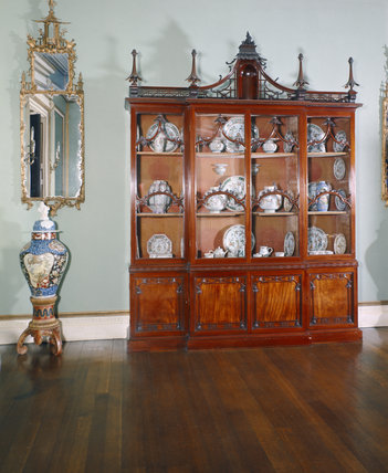 The Chinese cabinet by Chippendale at Shugborough Hall containing Chinese porcelain and situated in the Blue Drawing Room