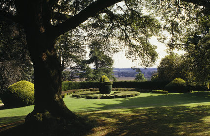 A sundial of box hedge topiary in the gardens at Ascott