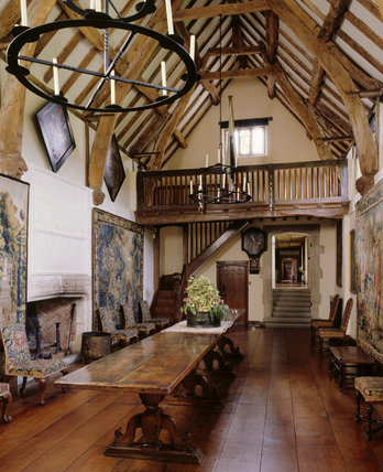 The Great Hall at Packwood House showing the long oak refectory table, fireplace and plaster overmantel, hatchments and timber ceiling