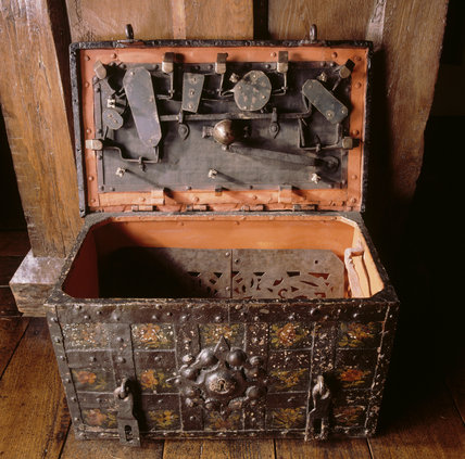 Close-up of the Armada chest in the Entrance Hall at Packwood House, showing the locks and contents