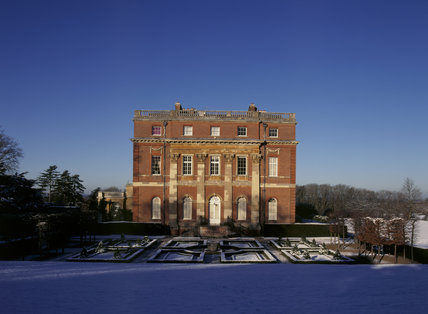 The south elevation of Clandon House, half lit by the winter sun The snow covered parterre, in shade, lies in the foreground