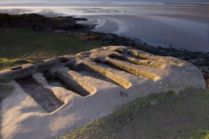 The rock-cut graves at Heysham Head, Lancashire, looking towards the estuary of Morecambe Bay