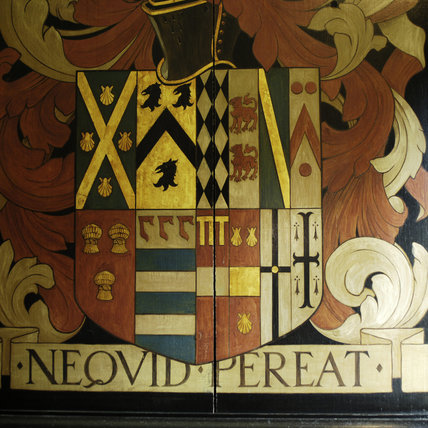 The Wade family coat of arms in the Entrance Hall at Snowshill Manor, Gloucestershire