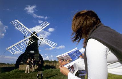 Visitor near the windpump (windmill) at Wicken Fen, Cambridgeshire