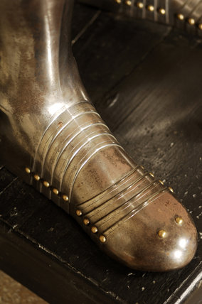 Close view of the foot of a suit of German armour at Snowshill Manor, in the room known as Dragon