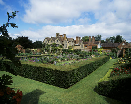 The Carolean formal sunken garden, looking north towards the C16th century Packwood House