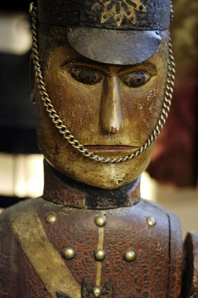 The face of a  wind toy of a soldier, part of the Charles Wade collection of toys in Seventh Heaven at Snowshill Manor