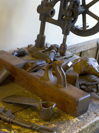 A drill, plane and assorted tools on the bench at Finch Foundry where hand tools used in agriculture and mining were produced in the C19th and C20th