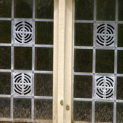 Close view of a glass and leaded light window at Mottisfont Abbey