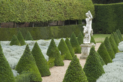 Statue of Bacchus, a survivor from the C17th Lauderdale's garden, in the Cherry Garden at  Ham House, Surrey