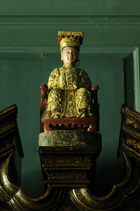 An Indonesian figure, part of Charles Paget Wade's collection, in the Turquoise Hall at Snowshill Manor, Gloucestershire