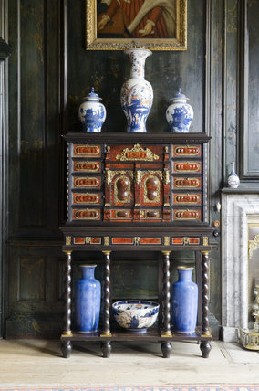 A late seventeenth-century cabinet on a stand from Antwerp in the Chapel Drawing Room at Belton House, Lincolnshire, UK