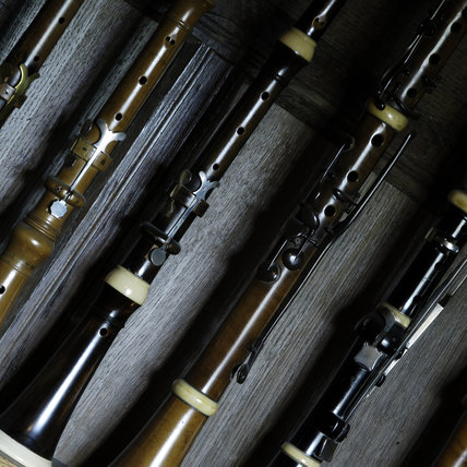 Close view of clarinets, flutes, piccolo and oboes, part of the musical instrument collection of Charles Paget Wade, in the Music Room at Snowshill Manor, Gloucestershire