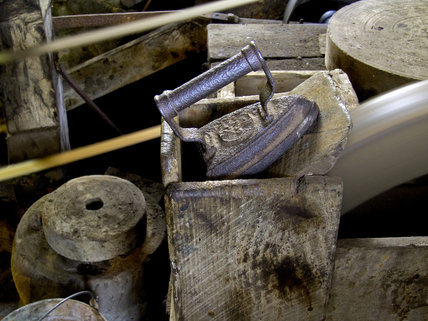 Close view inside Finch Foundry showing an iron and the wheels used for sharpening metal