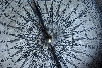 Close view of the face of a compass, in Admiral at Snowshill Manor