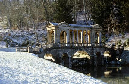 The Palladian Bridge at Prior Park Landscape Garden, Bath, under a dusting of snow