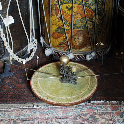 Close view of a drum and planetarium in Admiral, a room of c.1720 with a large collection of nautical objects at Snowshill Manor.