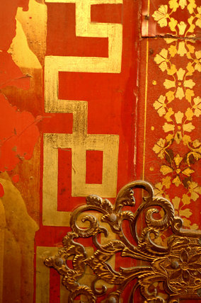 Close view of the detail of a French, red lacquered cabinet in the Grey Room at Snowshill Manor