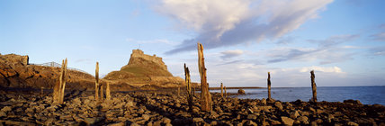 View towards Lindisfarne castle in evening light
