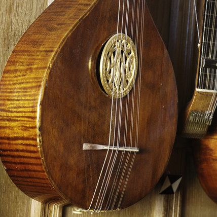 An English guitar of 1870, part of the musical instrument collection of Charles Paget Wade in the Music Room at Snowshill Manor, Gloucestershire