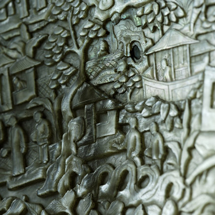 Close view of carved Chinese scenes, in Zenith, part of the Chales Wade collection at Snowshill Manor, Gloucestershire