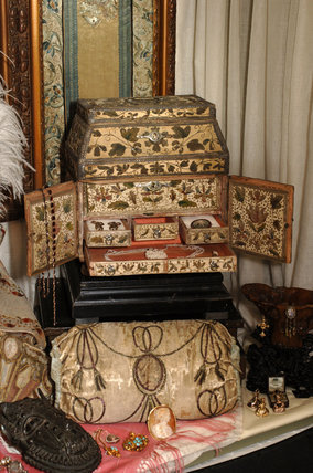 Close view of jewellery and the C17th stumpwork box in which it is kept, part of the Charles Wade collection, in Occidens, the room which used to house the costume collection, Snowshill Manor