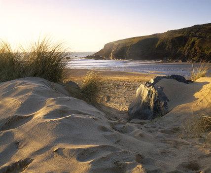 Poldhu cove, view past dune to beach on the Lizard peninsula, Cornwall