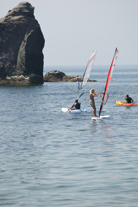 Windsurfing and kayaking off South Milton Sands, Devon.