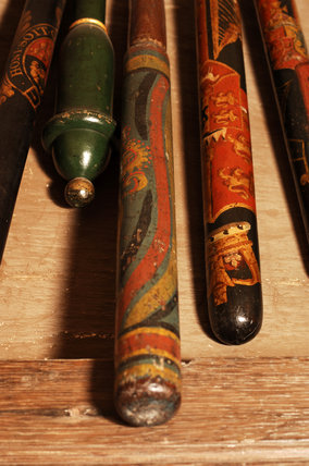 Close view of a collection of decorated truncheons, in the Lobby at Snowshill Manor, home of collector Charles Wade
