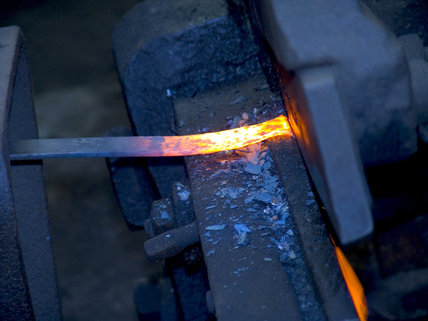Hot metal being cut by water-powered shears at Finch Foundry.