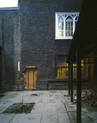 Looking across the courtyard towards the West Wall (1525) The C16th Armada window was inserted in 1700 and the porch was added in 1904, the door is original